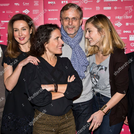 French jury members from left, writer Mazarine Pingeot, the daughter of late French President Francois Mitterrand, actor Christophe Rossignon and President of the jury actress Julie Gayet pose for photographers during a photo call for the Jury at the short film festival Courts Devant in Paris
