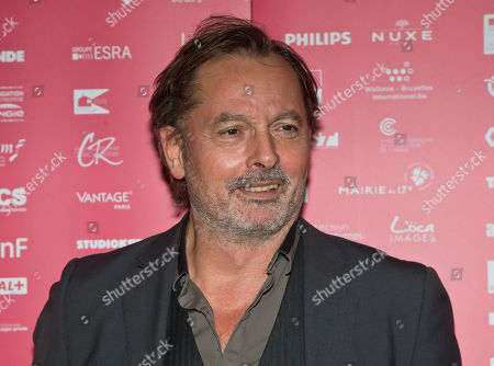 Jury member French actor Christophe Aleveque poses during a photo call for the Jury at the short film festival Courts Devant in Paris