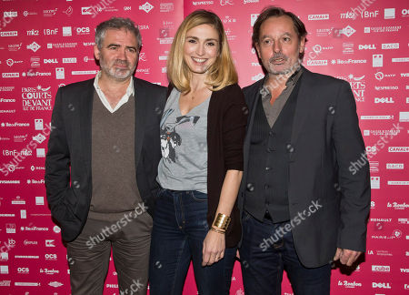 French jury members from left, director Stephane Brize, actress Julie Gayet and actor Christophe Aleveque pose during a photo call for the Jury at the short film festival Courts Devant in Paris