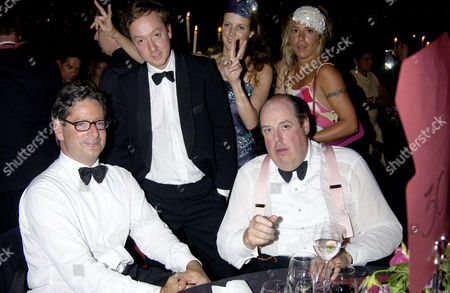 Stock Image of Garrard Celebrate A New Era in Their History with A Party at the Tower of London Dominic Lawson Geordie Greig and Nicholas Soames Pose For A Photograph with Tilly Boone and Cozmo Jenks Make Bunny Ears in the Background
