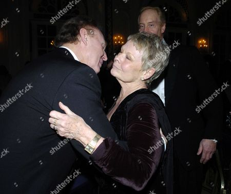 The Evening Standard British Film Awards at the Savoy Hotel London Dame Judi Dench with Tim Piggott-smith