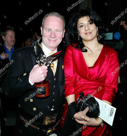 Stock Image of 2011 Evening Standard British Film Awards at the London Film Museum County Hall Southbank Robina Qureshi and Peter Mullen