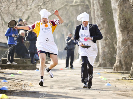 Annual Rehab Uk Parliamentary Pancake Race in Victoria Gardens Westminster Toby Perkins Mp (9) and Tom Bradley (11)