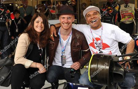 Stock Image of Formula 1 Santander British Grand Prix Race Day at Silverstone Gemma Arterton Michael Fassbender and Goldie