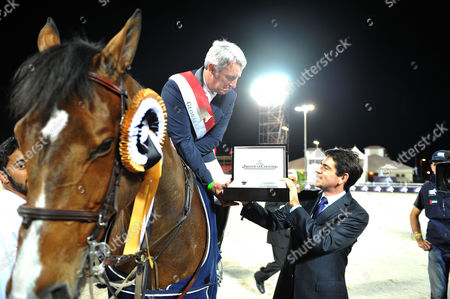 Global Championship Show Jumping Final at the Al Forsan International Sports Resort Abu Dhabi United Arab Emirates Roger-yves Bost Receives with Prize From Jerome Lambert Ceo of Jaeger-lecoultre