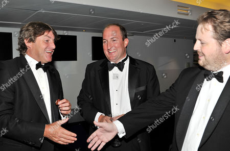 Gq Awards at the Royal Opera House Charlie Brooks Guto Harri and Matthew D'ancona