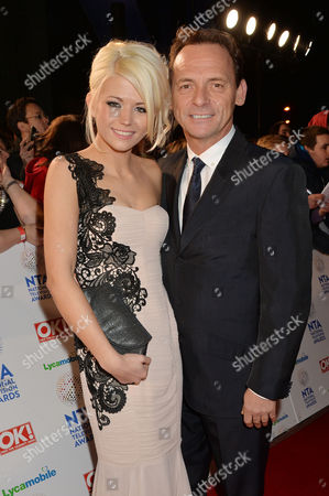 National Television Awards Arrivals at the O2 Danielle Harold and Perry Fenwick