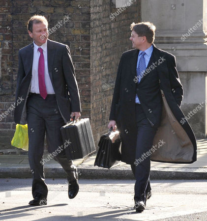 Cabinet Meeting at Number 10 Downing Street Westminster Cabinet Secretary Sir Gus O'donnell (r) Greets A Fellow Worker
