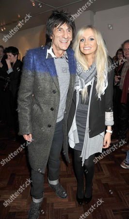Stock Image of Symbolic Collection Presents Ronnie Wood - Faces Time and Places at the Gallery Cork St Ronnie Wood with His Girlfriend Nicola Sargent