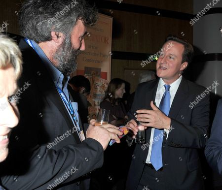 2010 Conservative Party Conference at Birmingham the Spectator Party Prime Minister David Cameron & Steve Bell *** Local Caption ***