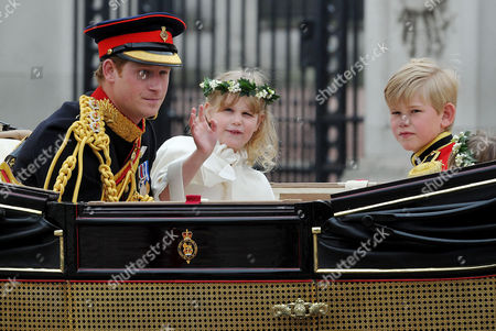 the Wedding of William Prince of Wales to Catherine Middleton Harry Prince of Wales Rides in the Carriage From Westminster Abbey Towards Buckingham Palace with Bridesmaid Lady Louise Windsor and Tom Pettifer