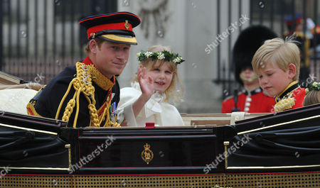 Stock Image of the Wedding of William Prince of Wales to Catherine Middleton Harry Prince of Wales Rides in the Carriage From Westminster Abbey Towards Buckingham Palace with Bridesmaid Lady Louise Windsor and Tom Pettifer