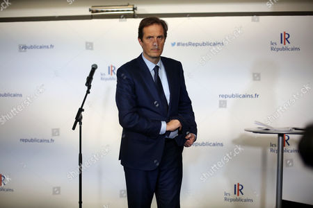 "Francois Fillon's spokesman, Jerome Chartier, gives a press conference after a meeting at the right wing party ""Les Republicains"" headquarter, in Paris"