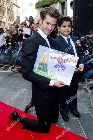 Stock Photo of 'The Amazing Spiderman' Gala Premiere at the Odeon Leicester Square Andrew Garfield and Medicinema User Uzayr Haider (7) Who is Recovering From A Recent Kidney Transplant Told How Medicinema Helps Him to Forget About His Treatment and Raised £12 000 Through A Special Auction Lot For Spiderman 4 Premier Tickets His All Time Favourite Film His Story Caused A Bidding War Between Substance and Unick Architects Who Shared the Lot and Donated A Matching Sum