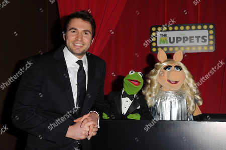 Stock Photo of 'The Muppets' Uk Premiere at the Mayfair Hotel Composer Nathan Pacheco Poses with Kermit and Miss Piggy