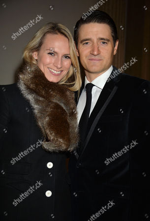 Stock Photo of 'White Christmas' Press Night and Afterparty at the Dominion Theatre and Bloomsbury Ball Room Tom Chambers with His Wife Clare Harding