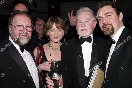 Olivier Awards and Afterparty at the Grosvenor House Hotel Park Lane Duncan Weldon Sir Derek Jacobi Shows Samantha Bond His Award For Best Actor Twelfth Night and Alexander Hanson