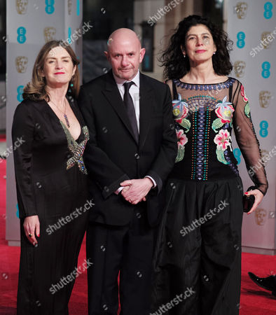 Bafta Film Awards Outside Arrivals at the Royal Opera House Finola Dwyer Nick Hornby and Amanda Posey