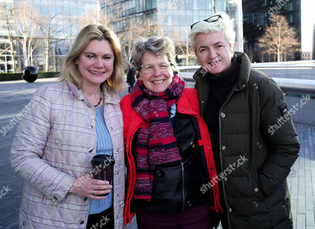 Stock Picture of Care International's Walk in Her Shoes in Support of International Women's Day at the Scoop More London Riverside Justine Greening Mp Sandi Toksvig with Her Wife Debbie Toksvig