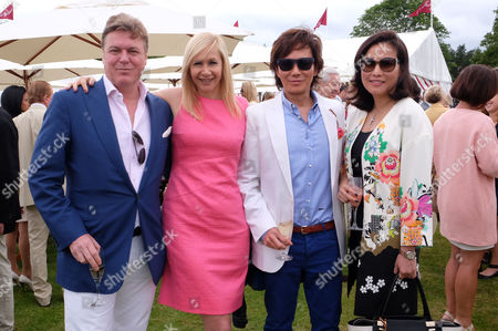 Stock Picture of Cartier Queens Cup Final at Smiths Lawn Windsor Great Park Berkshire Rod Barker with His Partner Tania Bryer with Andy and Patti Wong