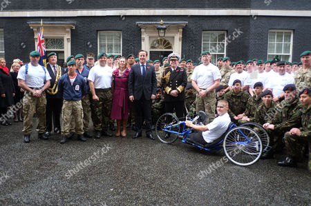 Stock Picture of Commando 999 Speedmarch (royal Marines Who Serve with the Uk Emergency Services) Begins in Downing Street They Aim to Raise £1 Million For the Royal Marines Association by 2014 David Cameron and First Sea Lord Admiral Sir Mark Stanhope with the Marines