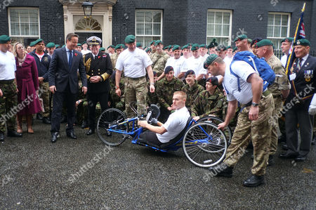 Stock Image of Commando 999 Speedmarch (royal Marines Who Serve with the Uk Emergency Services) Begins in Downing Street They Aim to Raise £1 Million For the Royal Marines Association by 2014 David Cameron and First Sea Lord Admiral Sir Mark Stanhope with the Marines