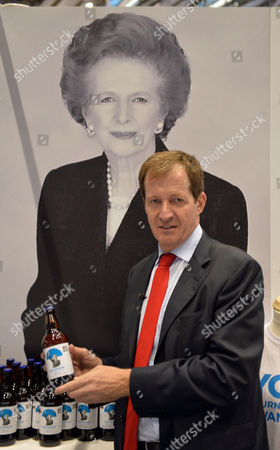 The 2013 Conservative Party Conference at Manchester Central Manchester City Centre Petersfield Great Britain Alastair Campbell On the Thatcher Stand with A Bootle of Maggie Beer