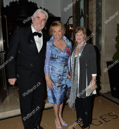 Dame Joan Collins Damehood Party at Claridges Ballroom Mayfair London Dame Esther Rantzen with Pauline Collins and John Alderton