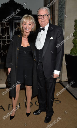 Dame Joan Collins Damehood Party at Claridges Ballroom Mayfair London Lord Tim Bell and His Partner Jackie Phillips
