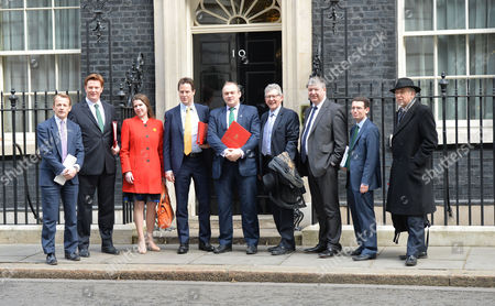 Stock Image of Final Cabinet Meeting of This Government Nick Clegg and His Lib Dem Cabinet Members Pose Up On the Doorstep of Number 10 Downing Street On Their Way in to the Last Joint Cabinet Meeting of This Parliament David Laws Danny Alexander Jo Swinson Nick Clegg Ed Davey Don Foster Alistair Carmichael Simon Wright Dr Vince Cable
