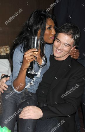 Stock Image of Gala Screening and Tea Party For Disney's 'The Princess and the Frog' at the Mayfair Hotel Mayfair Sinitta with Her Boyfriend Stefano Zagni (age 43 not 50 As Previously Reported)