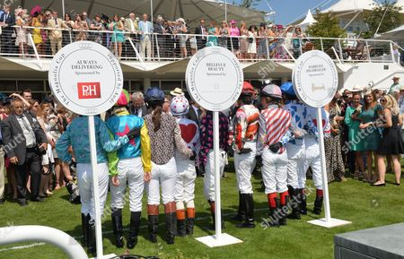 Glorious Goodwood Horse Racing Ladies Day at Goodwood West Sussex the Magnolia Cup Jockeys - Dido Harding (co Talktalk Group) Alexis Green Lucy Henman Tricia Simonon Philippa Holland Francesca Cumani Maggie Buggie (vice President of Capgemini) Krissi Murison and Gina Bryce