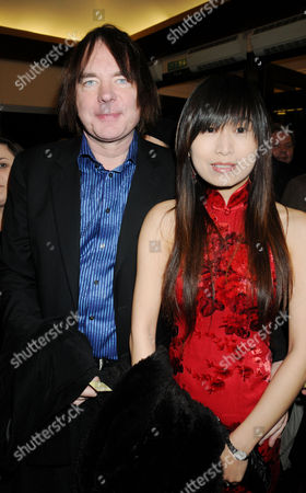 Press Night For 'Love Never Dies' Arrivals at the Adelphi Theatre Julian Lloyd Webber with His Wife Jiaxin Cheng