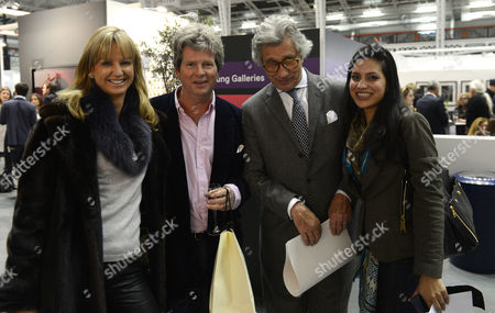 Stock Image of Private View at Art13 Olympia Grand Hall London Guy Sangster Fiona Sangster Arnaud Bamberger