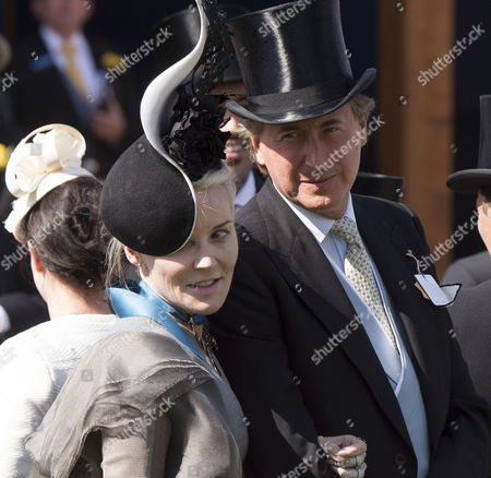 Stock Photo of the Investec Derby Festival at Epsom Racecourse Epsom and Ewell in Surrey Daphne Guinness and Robin Hurlstone
