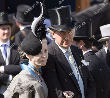 Stock Picture of the Investec Derby Festival at Epsom Racecourse Epsom and Ewell in Surrey Daphne Guinness and Robin Hurlstone