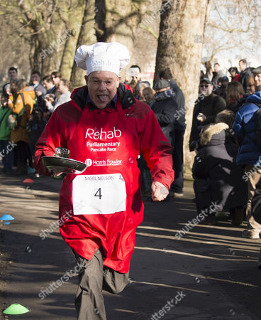 the Rehab Parliamentary Pancake Race Mps Lords Political Correspondents and Members of the Media Compete in the Fundraiser Organised by the Rehab Disability Charity to Support the Its Work with Disabled People at Victoria Tower Gardens Westminster Nigel Nelson of the Sunday People and Andrew Rosindell Mp ( Romford)