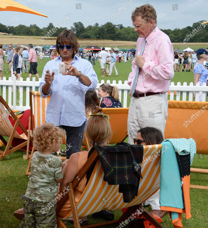 Stock Picture of Veuve Clicquot Gold Cup at Cowdray Park Polo Club Jodie Kidd with Her Father Johnny Kidd Her Ex-boyfriend Andrea Vianini and Their Son Indio Vianini Kidd
