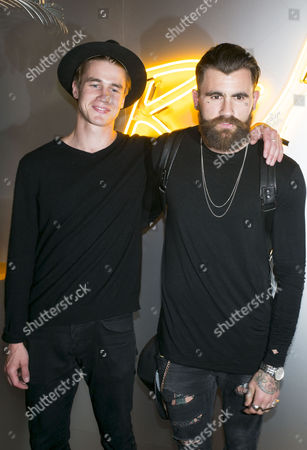 Veuve Cliquot Rich List Launch Party at the Cafe Royal Simo Kirk and Chris Perceval