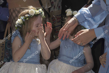 Wedding at St John the Baptist Cirencester Bridesmaid Beatrice Rose Hart the Bride's Niece is Overcome by the Occasion