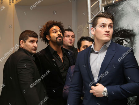 David Haye shouting at Tony Bellow (out of Frame) after a fight broke out during the attempt at a head to head photograph pose during the press conference between David Haye and Tony Bellew at The Dorchester Hotel to preview their fight in March 2017, London on 30th November 2016