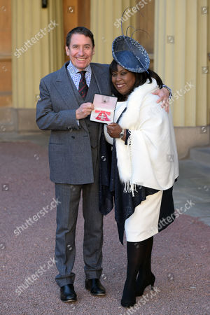 Stock Photo of Ruby Turner receives an MBE for services to Music She is pictured with her friend Jools Holland.