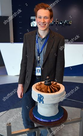 Aerospace engineer and Bake Off runner-up Aero Andrew Smyth poses with his cake in the shape of an engine, at the Rolls Royce technology centre in Derby