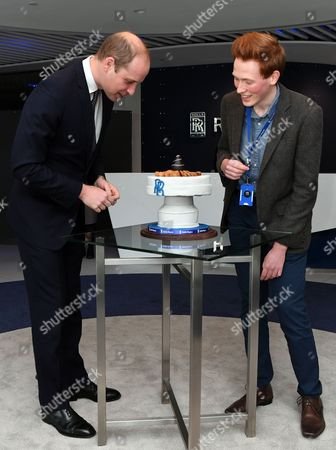 Prince William is presented with a cake by Aerospace engineer and Bake Off runner-up Aero Andrew Smyth during a visit to the Rolls Royce technology centre in Derby