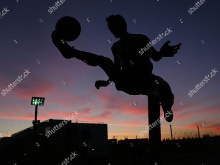 Dennis Bergkamp statue outside 'The Emirates' in the sunset three hours prior to kick-off during Arsenal vs Southampton, EFL Cup Football at the Emirates Stadium on 30th November 2016