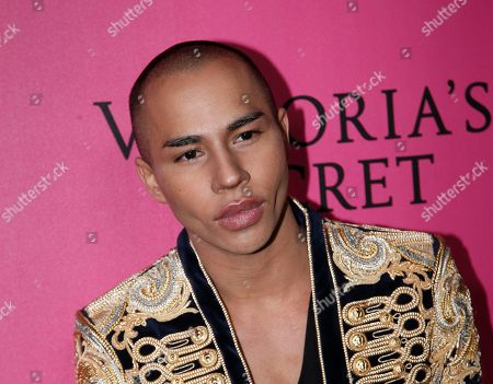 Stock Picture of French fashion designer Olivier Rousteing poses for photographers during the pink carpet before the Victoria's Secret fashion show in Paris. The pulse-quickening, celebrity-filled catwalk event of the year: the Victoria's Secret fashion show takes place in Paris with performances from Lady Gaga and Bruno Mars