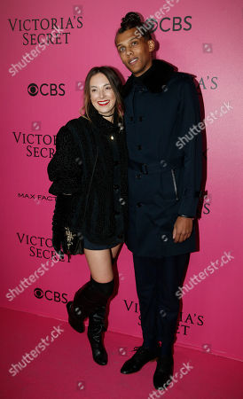 Belgian singer Stromae and wife Coralie Barbier pose for photographers during the pink carpet before the Victoria's Secret fashion show in Paris. The pulse-quickening, celebrity-filled catwalk event of the year: the Victoria's Secret fashion show takes place in Paris with performances from Lady Gaga and Bruno Mars