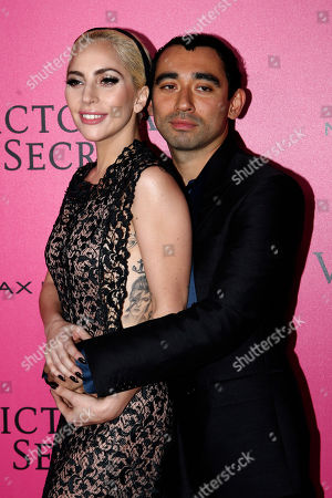 Nicola Formichetti kisses Lady Gaga during the photocall before the Victoria's Secret fashion show in Paris. The pulse-quickening, celebrity-filled catwalk event of the year: the Victoria's Secret fashion show takes place in Paris with performances from Lady Gaga and Bruno Mars