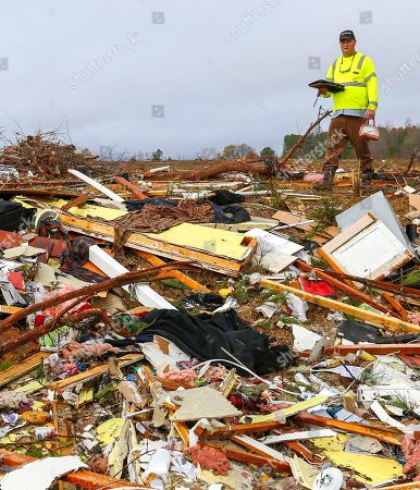 Stock Image of Bob Wright looks for personal belongings after a suspected tornado ripped through the town of Rosalie, killing three of his brother's family members, in Rosalie, Ala