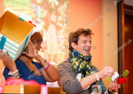 """Gayle King, Adam Glassman Gayle King, left, editor-at-large for """"O, The Oprah Magazine"""" lifts a box as the magazine's creative director Adam Gassman, unveils a sachet during an event previewing """"Oprah's Favorite Things,"""" the television star's Christmas gift picks, in New York"""